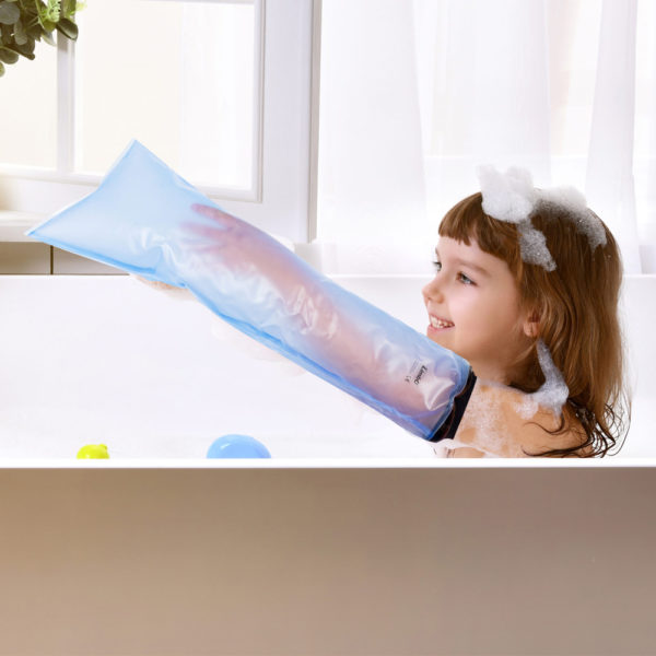 Young girl sitting in the bath wearing a LimbO Child's Full Arm Waterproof Protector on her left arm