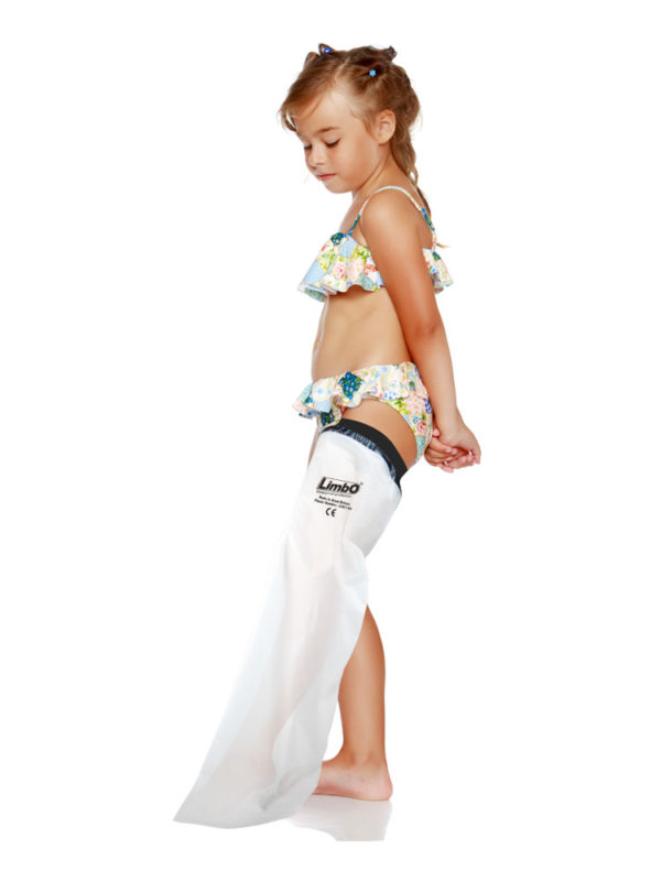 Young girl standing up and wearing a full leg LimbO Waterproof Protector on her left leg