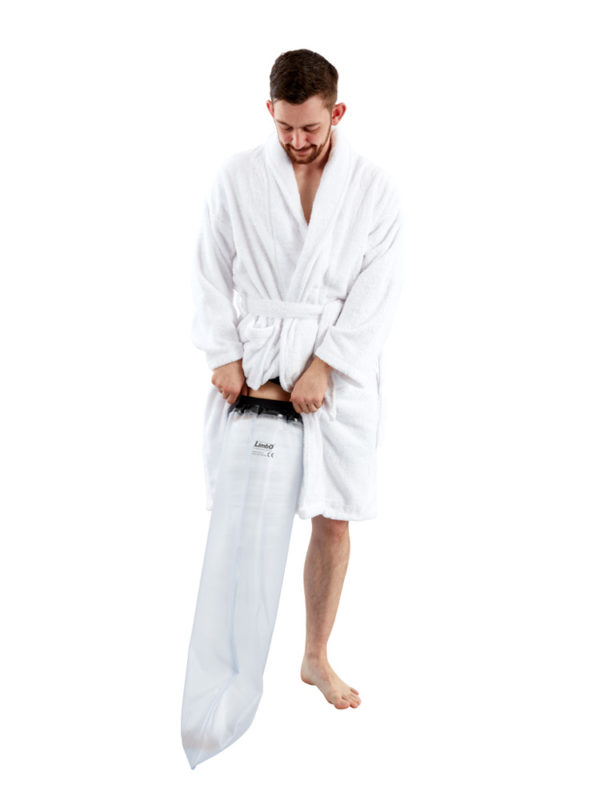 Man in a white dressing gown standing up and wearing a LimbO Full Leg Cast Waterproof Protector on his right leg