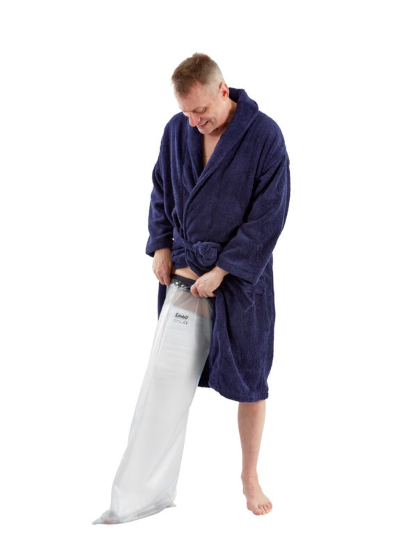 Man in blue dressing gown standing up and wearing a LimbO Full Leg Cast Waterproof Protector on his right leg