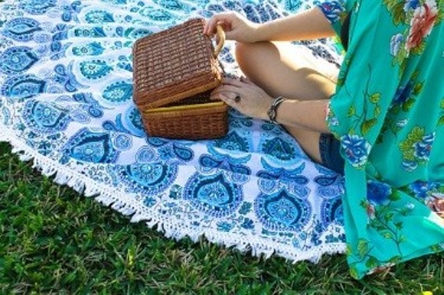 Woman on a picnic blanket