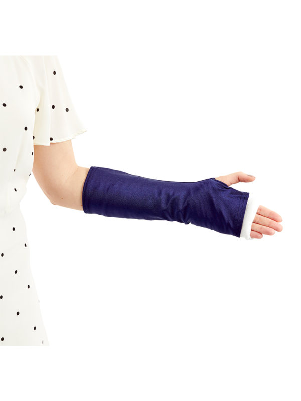 A close up of woman standing and wearing a blue coloured LimbO Arm Cast Sleeve on her left arm.