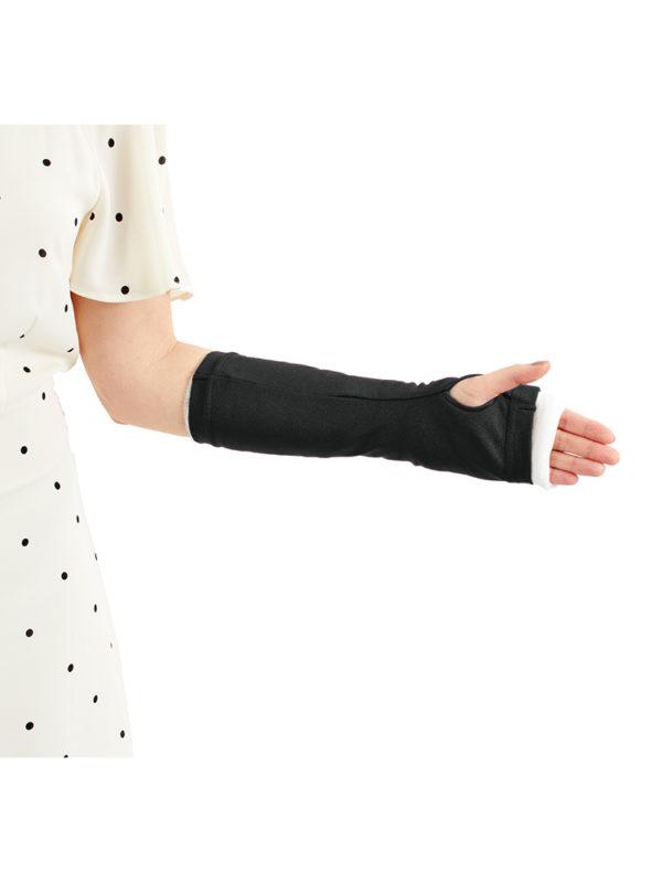 A close up of a black LimbO Arm Cast Sleeve on a lady's left arm