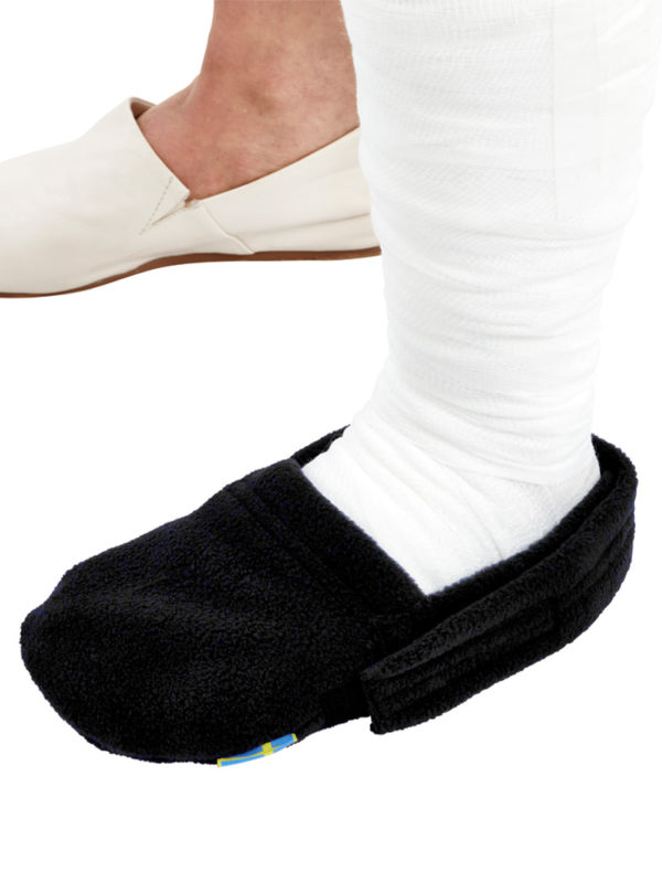 A close up of the black LimbO Toe Cozy being worn on a plaster cast