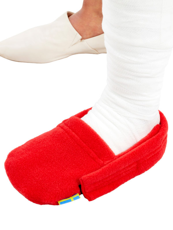 A close up of the red LimbO Toe Cozy being worn on a plaster cast
