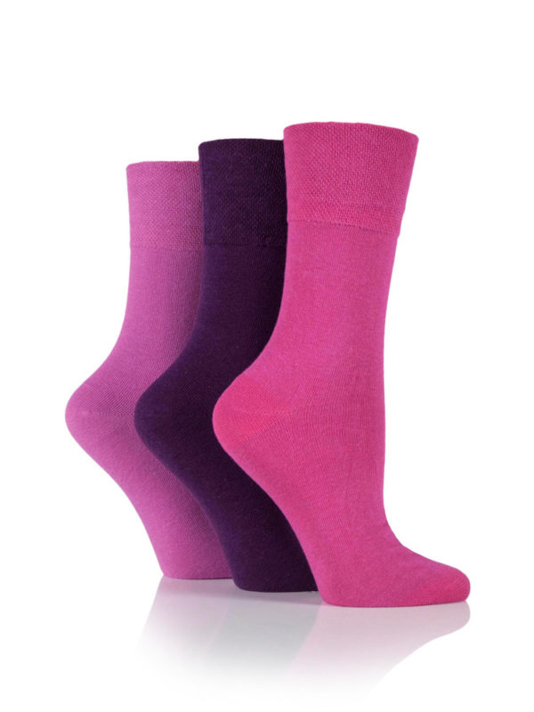 An image of three socks being worn and the variations of pink that are available in the Gentle Grip Socks range