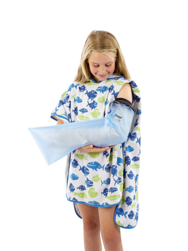 Young girl standing up and wearing a LimbO child's full arm waterproof cast protector on her left arm