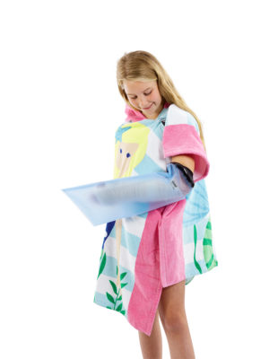 Young girl dressed in a towel, standing up and wearing a LimbO Child's Half Arm Cast Protector on her left arm