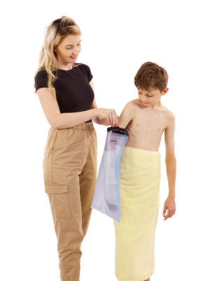 Young boy standing up with his Mum, both are looking at his right arm on which he is wearing a LimbO Child's Half Arm cast protector