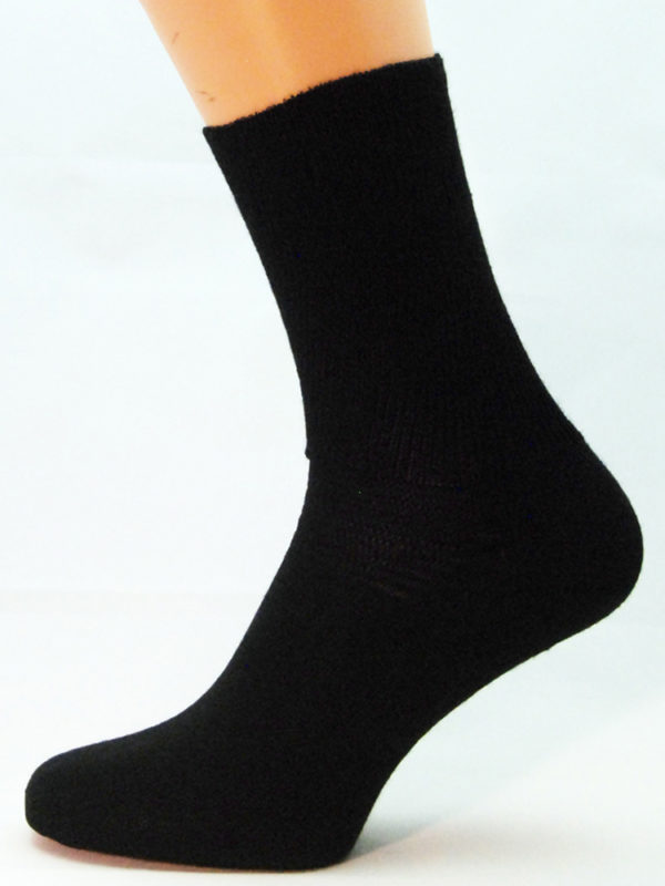 A black cotton Prosox Ankle Length Sock that has been placed on a mannequin leg to demonstrate the appearance when worn on an actual leg.