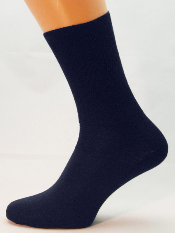 A navy blue cotton Prosox Ankle Length Sock that has been placed on a mannequin leg to demonstrate the appearance when worn on an actual leg.