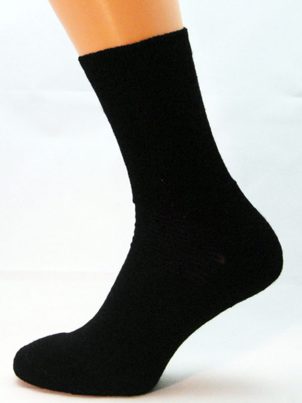 A black wool Prosox Ankle Length Sock that has been placed on a mannequin leg to demonstrate the appearance when worn on an actual leg