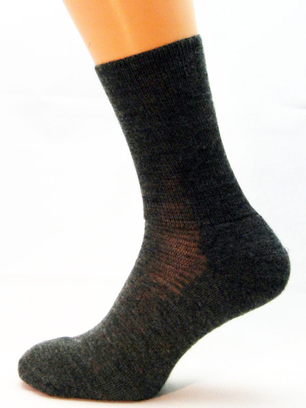 A grey wool Prosox Ankle Length Sock that has been placed on a mannequin leg to demonstrate the appearance when worn on an actual leg.