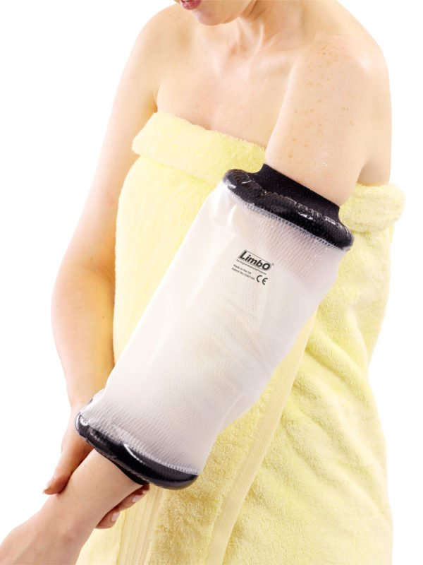 A close up shot of an adult elbow LimbO Waterproof Protector on an arm