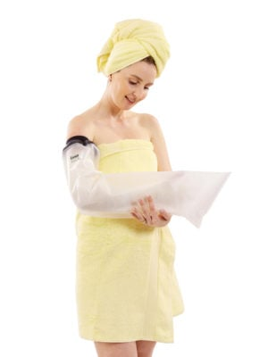 Woman in yellow towel wearing a full arm LimbO Waterproof Protector on her right arm