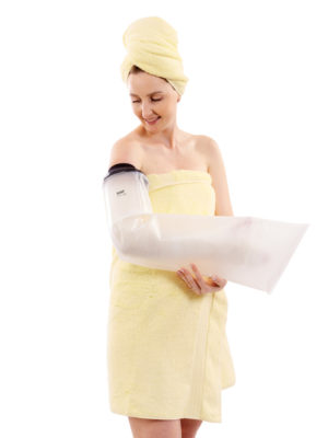 Woman in yellow towel wearing a LimbO Waterproof Protector on her right arm