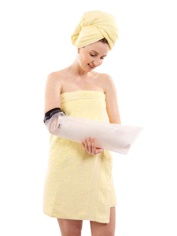 Woman in yellow towel wearing a half arm LimbO Waterproof Protector on the lower part of her right arm