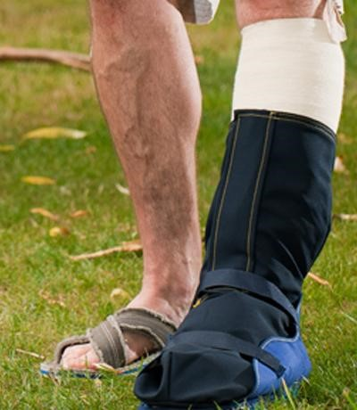 man wearing an outcast foot cover