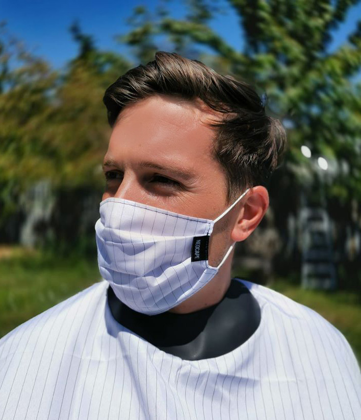 Young man wearing a white pinstripe coloured Neocape Reusable Face Mask