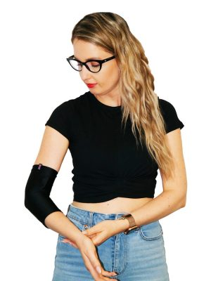 Woman standing up and wearing a black LimbO PICC Line Sleeve on her right arm.